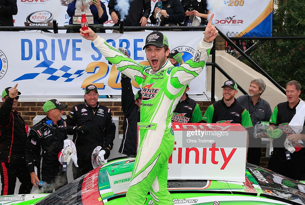 Daniel Suarez, driver of the #19 Interstate Batteries Toyota, celebrates in Victory Lane after winning the NASCAR XFINITY Series Drive Sober 200 at Dover International Speedway on October 2, 2016 in Dover, Delaware.