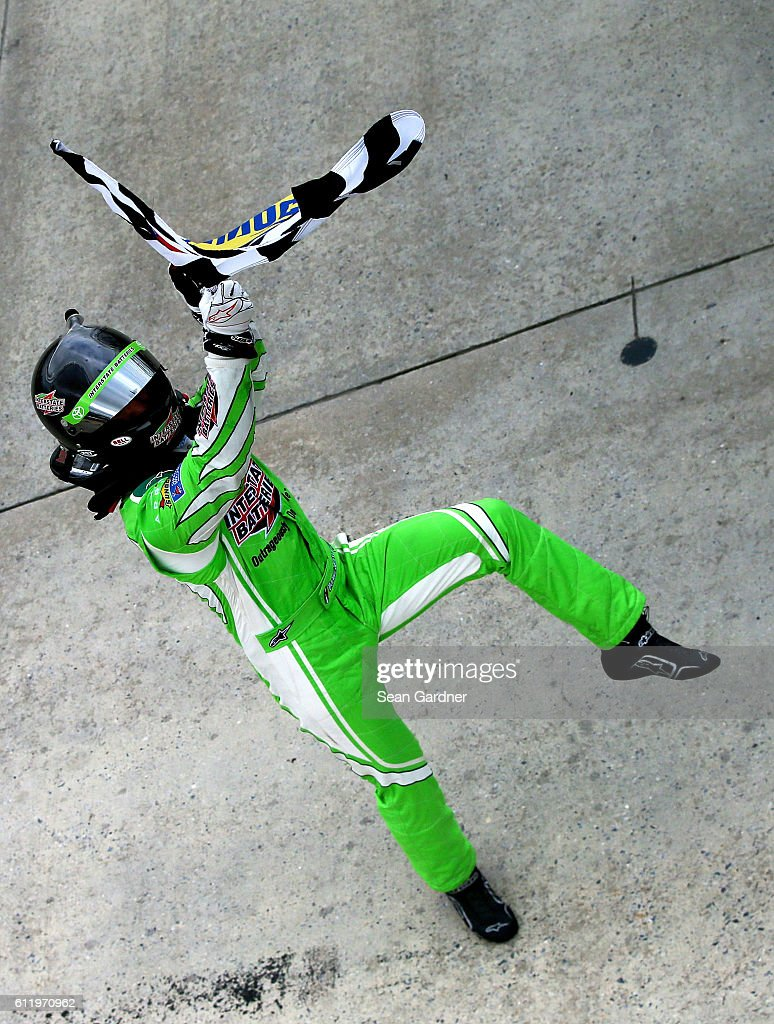 Daniel Suarez, driver of the #19 Interstate Batteries Toyota, celebrates with the checkered flag after winning the NASCAR XFINITY Series Drive Sober 200 at Dover International Speedway on October 2, 2016 in Dover, Delaware.