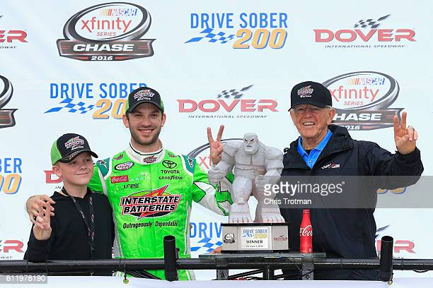 Daniel Suarez driver of the Interstate Batteries Toyota poses with team owner Joe Gibbs in Victory Lane after winning the NASCAR XFINITY Series Drive...