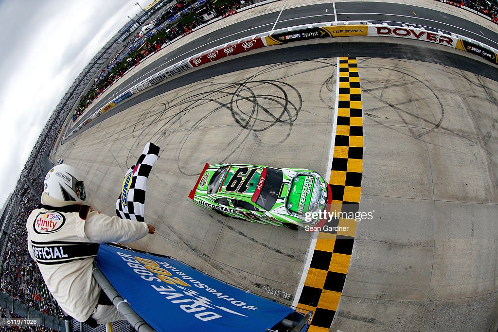 Daniel Suarez, driver of the #19 Interstate Batteries Toyota, takes the checkered flag to win the NASCAR XFINITY Series Drive Sober 200 at Dover International Speedway on October 2, 2016 in Dover, Delaware.