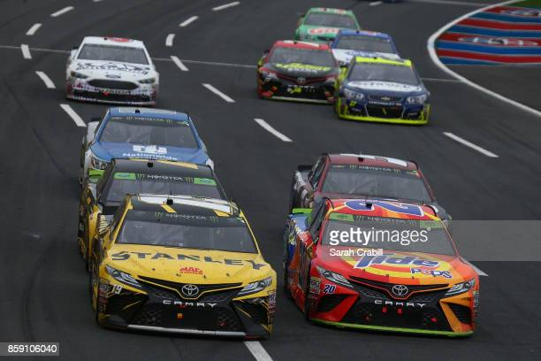 Daniel Suarez driver of the STANLEY Toyota and Matt Kenseth driver of the Tide Pods Toyota lead a pack of cars during the Monster Energy NASCAR Cup...
