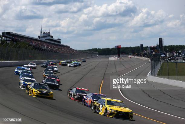 Daniel Suarez driver of the Stanley Toyota leads the field into turn one during the Monster Energy NASCAR Cup Series Gander Outdoors 400 at Pocono...