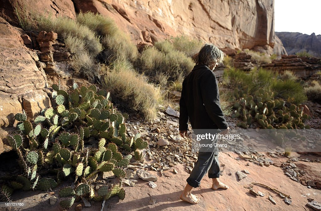 """(KL)Daniel Suelo is looking for leaves for the moring tea by his cave in Moab, UT. Suelo had a CU Masters degree in accounting and a promising career in 2000 when he began what he calls """"an experiment."""" Since that time nine years ago, he has lived without : News Photo"""
