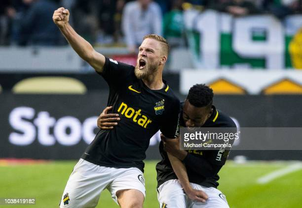 Daniel Sundgren and Heradi Rashidi of AIK celebrate AIK's victory after an Allsvenskan match between AIK and Hammarby IF at Friends Arena on...