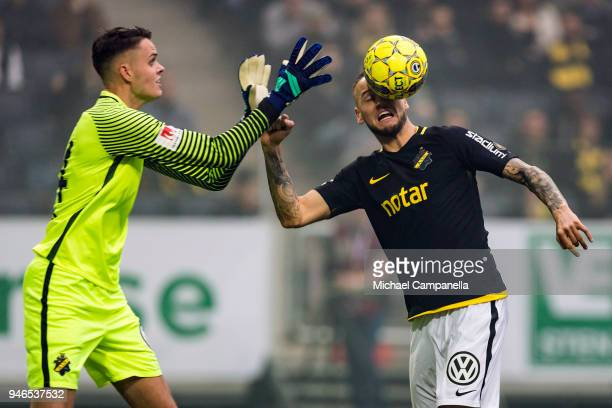 Daniel Sundgren clears the ball as before goalkeeper Oscar Linner can get to it during an Allsvenskan match between AIK and Djurgardens IF at Friends...