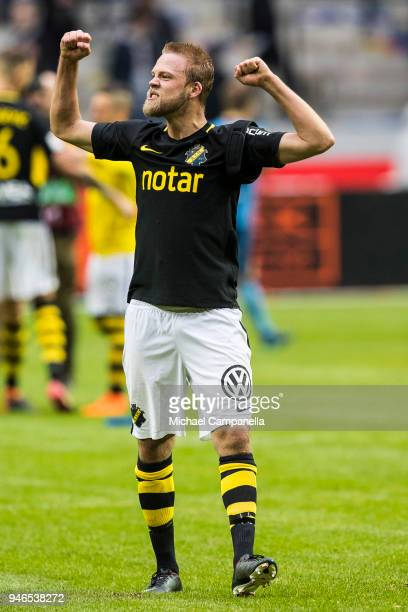 Daniel Sundgren of AIK celebrates AIK's 20 victory after the final whistle is blown during an Allsvenskan match between AIK and Djurgardens IF at...
