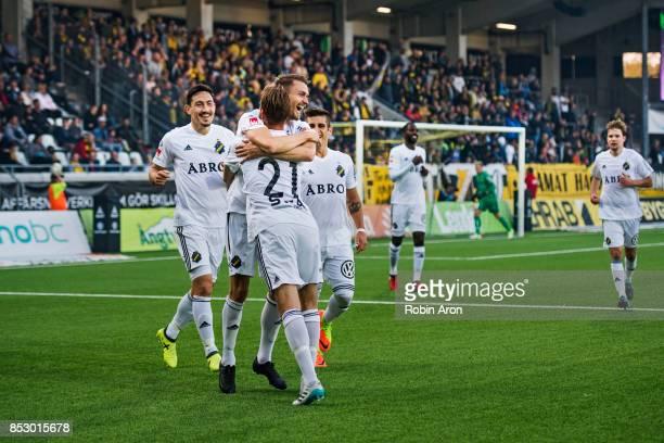 Daniel Sundgren of AIK celebrates with teammates after scoring 02 during the Allsvenskan match between BK Hacken and AIK at Bravida Arena on...