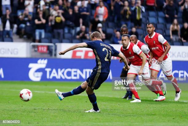 Daniel Sundgren of AIK scores the decisive goal to 11 from the penaty spot during the UEFA Europa League Qualifying match between AIK and SC Braga at...