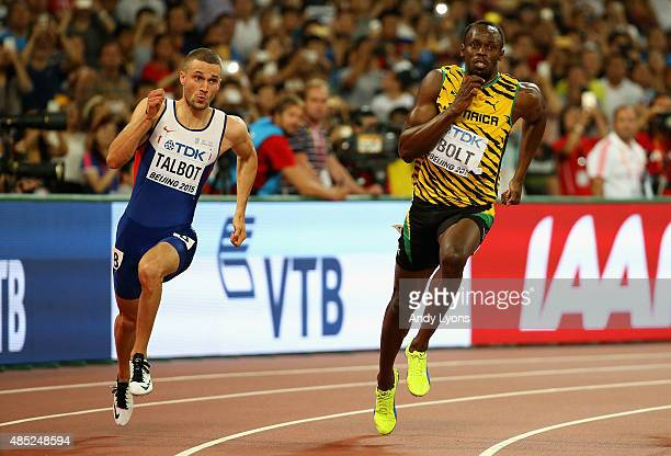 Daniel Talbot of Great Britain and Usain Bolt of Jamaica compete in the Men's 200 metres semifinal during day five of the 15th IAAF World Athletics...