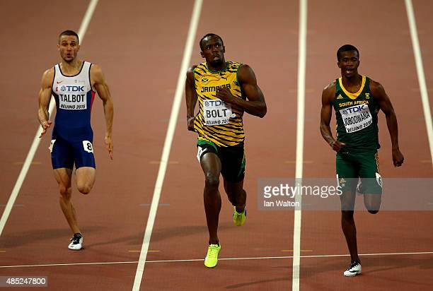 Daniel Talbot of Great Britain Usain Bolt of Jamaica and Anaso Jobodwana of South Africa compete in the Men's 200 metres semifinal during day five of...