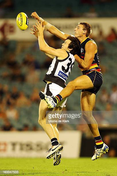 Daniel Talia of Adelaide spoils a mark by Frazer Dale of Carlton during the round three NAB Cup AFL match between the Adelaide Crows and the Carlton...