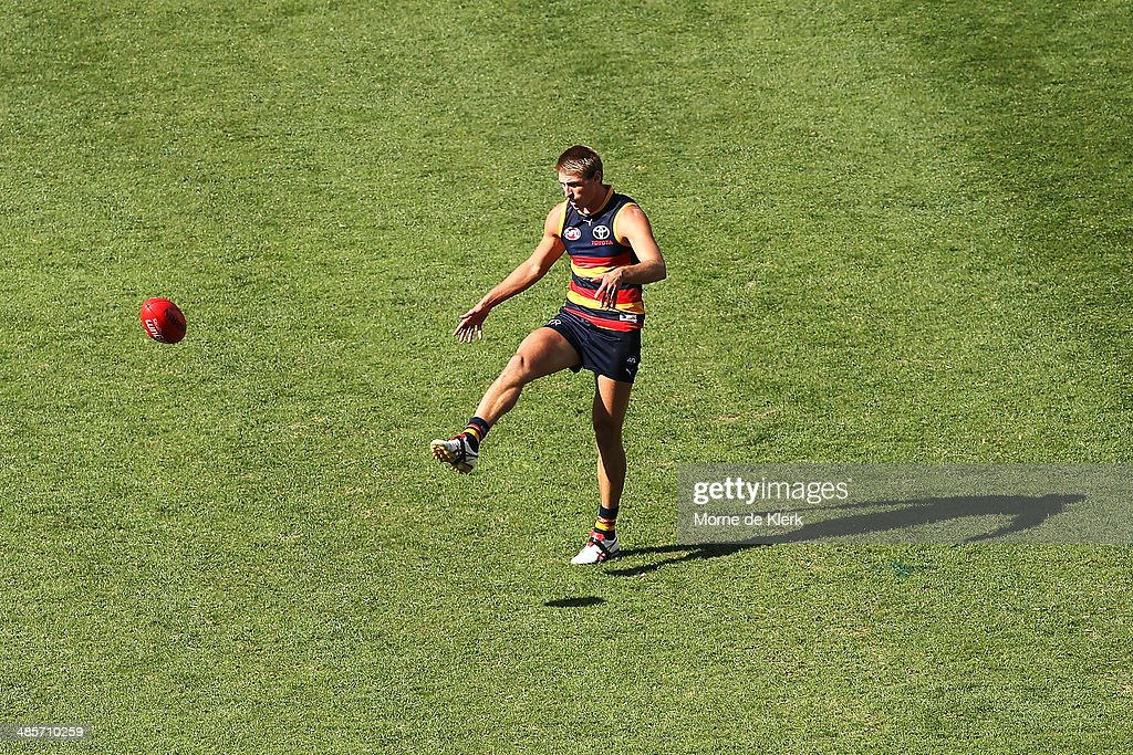 Daniel Talia of the Crows kicks the ball during the round five AFL match between the Adelaide Crows and the Greater Western Sydney Giants at Adelaide Oval on April 20, 2014 in Adelaide, Australia.