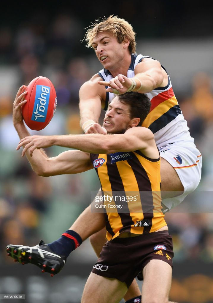 Daniel Talia of the Crows spoils a mark by Isaac Smith of the Hawks during the round two AFL match between the Hawthorn Hawks and the Adelaide Crows at Melbourne Cricket Ground on April 1, 2017 in Melbourne, Australia.