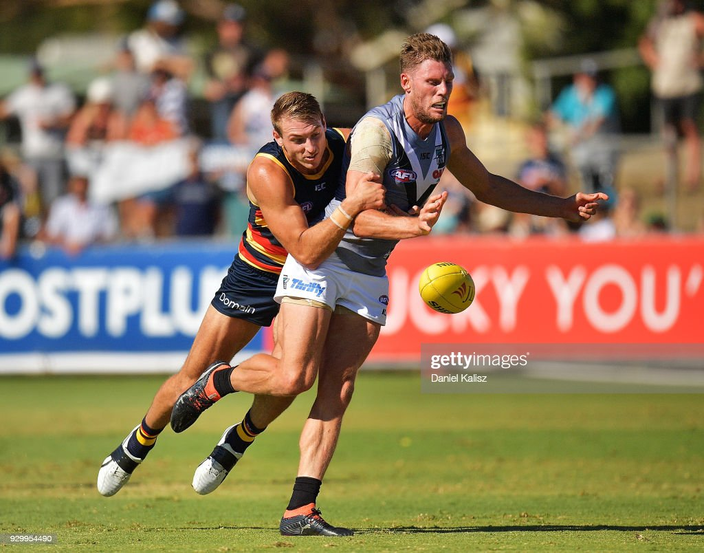 Daniel Talia of the Crows tackles Brad Ebert of the Power during the JLT Community Series AFL match between Port Adelaide Power and the Adelaide Crows at Alberton Oval on March 10, 2018 in Adelaide, Australia.