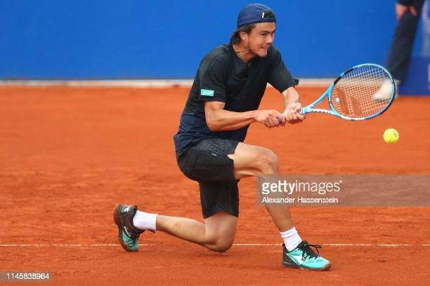 Daniel Taro of Japan plays a back hand during his first round match against Ugo Humbert of France on day 3 of the BMW Open at MTTC IPHITOS on April...