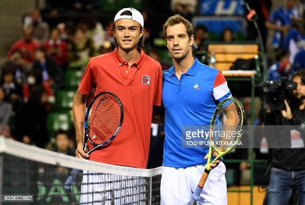Daniel Taro of Japan poses with Richard Gasquet of France prior to their first match at the Davis Cup tennis world group first round between Japan...