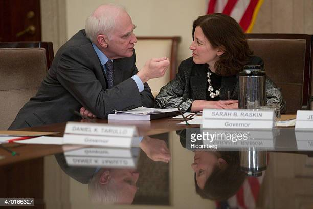 Daniel Tarullo governor of the US Federal Reserve left talks to Sarah Bloom Raskin governor of the Federal Reserve before an open meeting of the...