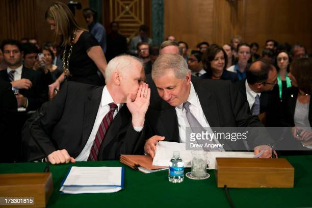 Daniel Tarullo , governor on the Board of Governors of the Federal Reserve, talks with Martin Gruenberg, chairman of the Federal Deposit Insurance...