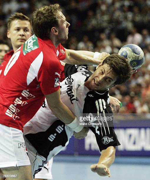 Daniel Tellander of Melsungen competes with Markus Ahlm of Kiel during the Handball Bundesliga match between THW Kiel and MT Melsungen at the Ostsee...