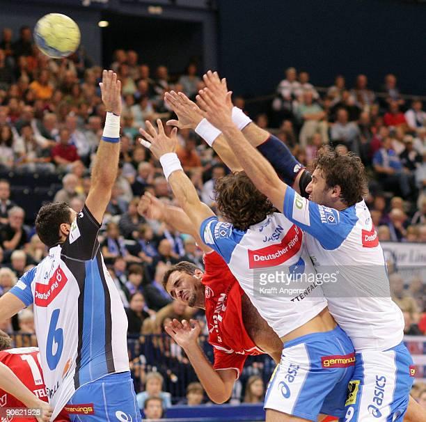 Daniel Tellander of Melsungen throws a goal during the Bundesliga Handball match between HSV Hamburg and MT Melsungen at the Colorline Arena on...