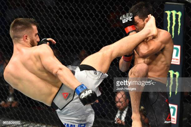 Daniel Teymur of Sweden kicks the head of Julio Arce in their featherweight fight during the UFC Fight Night event at the Adirondack Bank Center on...