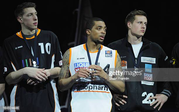 Daniel Theis Allan Ray and Bradley Buckman of Ulm look dejected after the Beko BBLTop Four final game between Ratiopharm Ulm and Alba Berlin at O2...