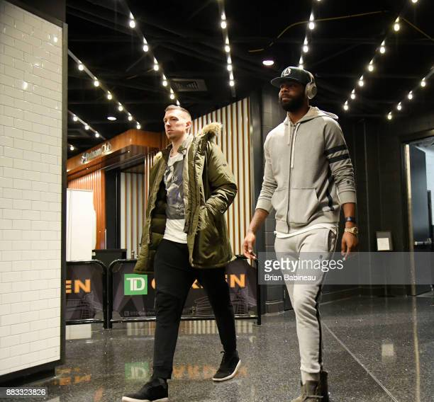 Daniel Theis and Marcus Morris of the Boston Celtics arrive before the game against the Philadelphia 76ers on November 30 2017 at the TD Garden in...