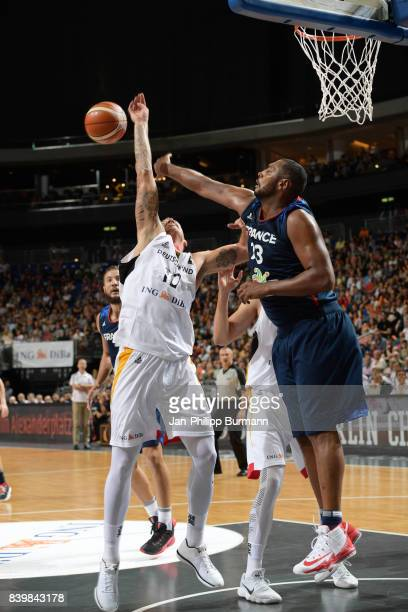 Daniel Theis of Team Germany and Axel Toupane of Team Frankreich during the game between Germany and France on august 27 2017 in Berlin Germany