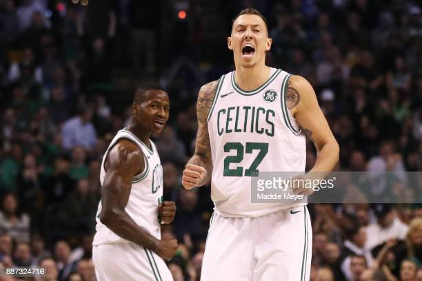 Daniel Theis of the Boston Celtics and Terry Rozier celebrate during the second half against the Dallas Mavericks at TD Garden on December 6 2017 in...