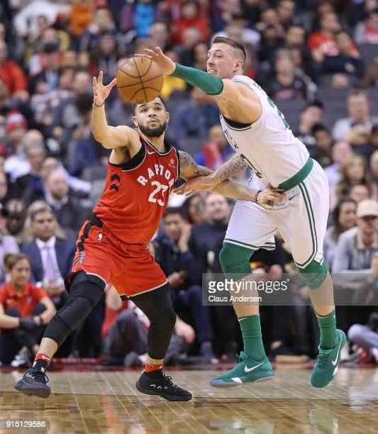 Daniel Theis of the Boston Celtics battles against Fred Vanvleet of the Toronto Raptors in an NBA game at the Air Canada Centre on February 6 2018 in...