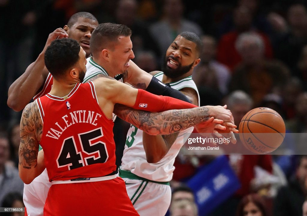 Daniel Theis #27 of the Boston Celtics battles for the ball with Denzel Valentine #45 and Cristiano Felicio #6 of the Chicago Bulls at the United Center on March 5, 2018 in Chicago, Illinois.