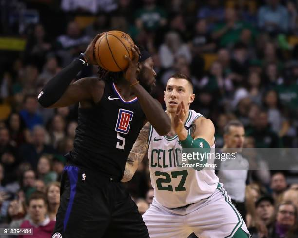 Daniel Theis of the Boston Celtics defends against Montrezl Harrell of the LA Clippers during the second half of the game at TD Garden on February 14...