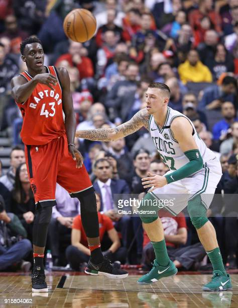 Daniel Theis of the Boston Celtics defends against Pascal Siakam of the Toronto Raptors in an NBA game at the Air Canada Centre on February 6 2018 in...