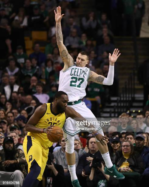 Daniel Theis of the Boston Celtics defends Al Jefferson of the Indiana Pacers during the fourth quarter at TD Garden on February 9 2018 in Boston...
