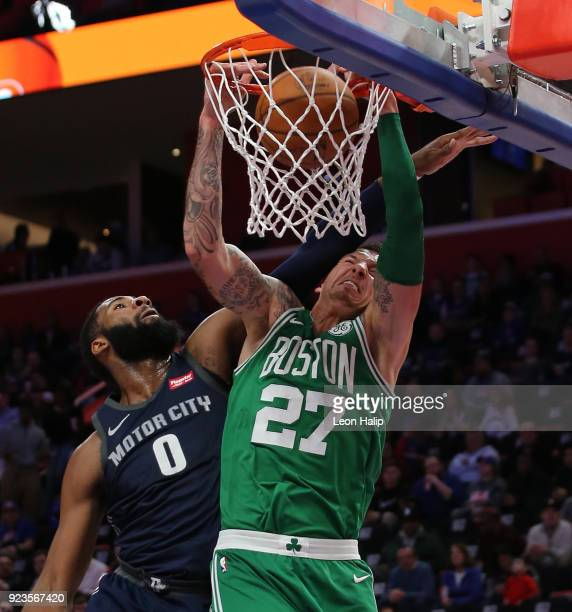Daniel Theis of the Boston Celtics drives the ball to the basket as Andre Drummond of the Detroit Pistons attempts to defend during the fourth...