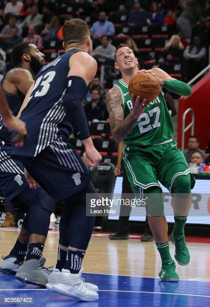 Daniel Theis of the Boston Celtics drives to the basket as Blake Griffin of the Detroit Pistons defends during the fourth quarter of the game at...
