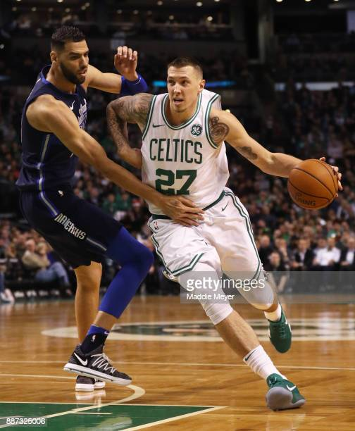 Daniel Theis of the Boston Celtics drives to the basket with pressure from Salah Mejri of the Dallas Mavericks during the second half at TD Garden on...
