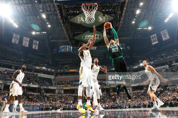 Daniel Theis of the Boston Celtics dunks against the Indiana Pacers on November 25 2017 at Bankers Life Fieldhouse in Indianapolis Indiana NOTE TO...