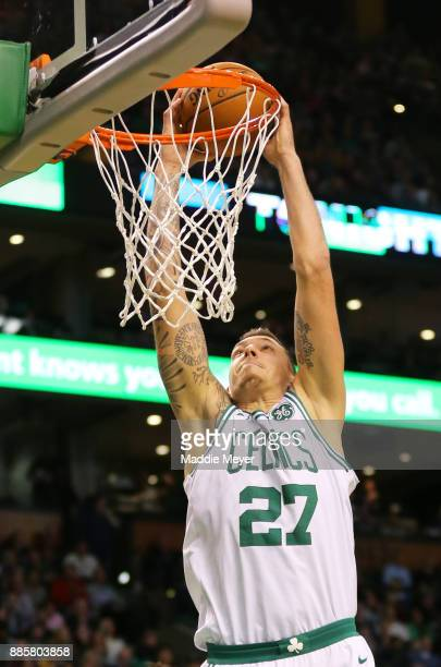 Daniel Theis of the Boston Celtics dunks during the second half against the Milwaukee Bucks at TD Garden on December 4 2017 in Boston Massachusetts...