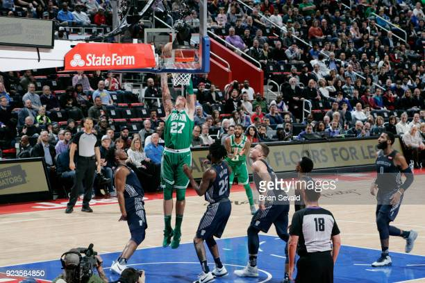 Daniel Theis of the Boston Celtics dunks the ball during the game against the Detroit Pistons on February 23 2018 at Little Caesars Arena in Detroit...