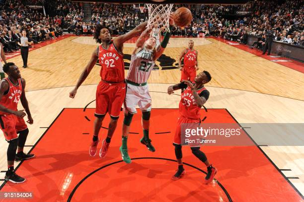 Daniel Theis of the Boston Celtics goes to the basket against Lucas Nogueira of the Toronto Raptors on February 6 2018 at the Air Canada Centre in...
