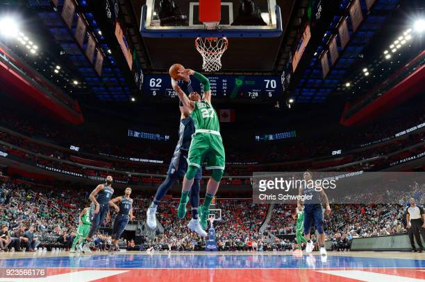 Daniel Theis of the Boston Celtics goes to the basket against the Detroit Pistons on February 23 2018 at Little Caesars Arena in Detroit Michigan...
