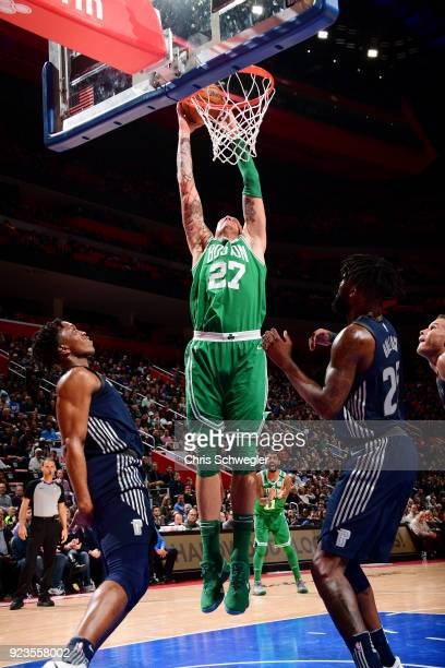 Daniel Theis of the Boston Celtics goes up for a dunk against the Detroit Pistons on February 23 2018 at Little Caesars Arena in Detroit Michigan...