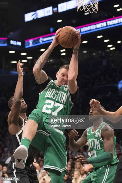 Daniel Theis of the Boston Celtics grabs a rebound during the NBA game against the Brooklyn Nets at Barclays Center on November 14 2017 in the...