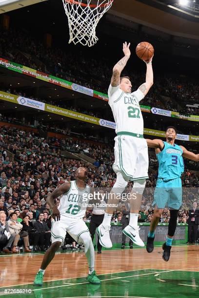 Daniel Theis of the Boston Celtics grabs the rebound against the Charlotte Hornets on November 10 2017 at the TD Garden in Boston Massachusetts NOTE...