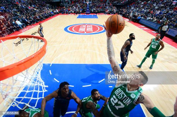 Daniel Theis of the Boston Celtics grabs the rebound against the Detroit Pistons on February 23 2018 at Little Caesars Arena in Detroit Michigan NOTE...
