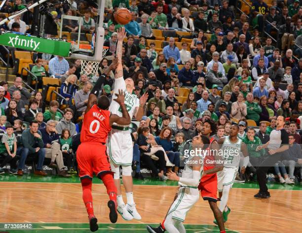 Daniel Theis of the Boston Celtics grabs the rebound during the game against the Toronto Raptors on November 12 2017 at the TD Garden in Boston...