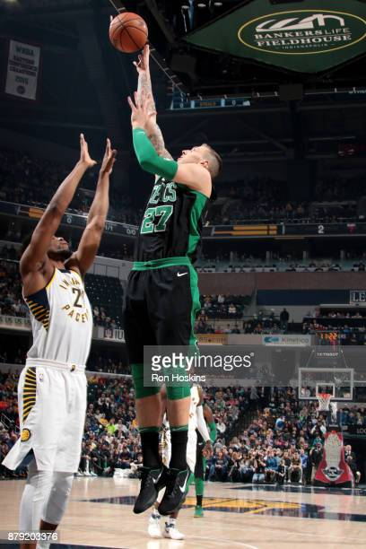 Daniel Theis of the Boston Celtics handles the ball against the Indiana Pacers on November 25 2017 at Bankers Life Fieldhouse in Indianapolis Indiana...