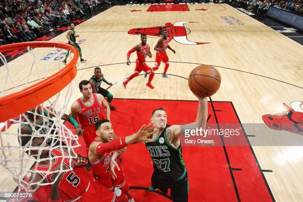 Daniel Theis of the Boston Celtics handles the ball against the Chicago Bulls on December 11 2017 at the United Center in Chicago Illinois NOTE TO...