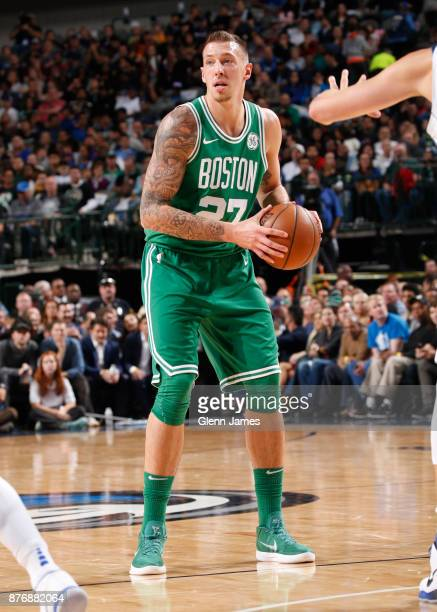 Daniel Theis of the Boston Celtics handles the ball during the game against the Dallas Mavericks on November 20 2017 at the American Airlines Center...